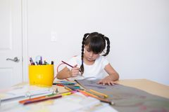 Girl making artwork stock image