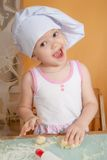 3 years old girl in cook role Royalty Free Stock Photos