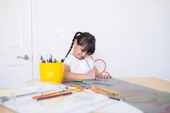 Happy girl coloring stock photos