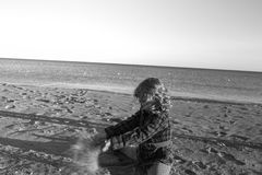 4 years old girl playing on the beach. preschool age group on beach royalty free stock photo