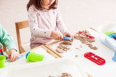 Child plays with sand Royalty Free Stock Photo