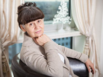 65 years old good looking woman portrait in domestic environment. London Royalty Free Stock Photos