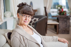 65 years old good looking woman portrait in domestic environment. Stock Photography