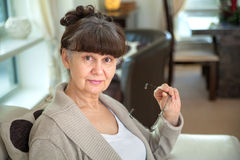 65 years old good looking woman portrait in domestic environment. Royalty Free Stock Photo
