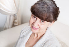 65 years old good looking woman portrait in domestic environment. Royalty Free Stock Image