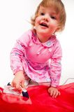 Little, blond hair girl ironing Stock Image