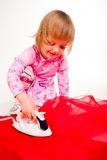 Little, blond hair girl ironing Stock Photos