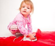 Little, blond hair girl ironing Royalty Free Stock Photography