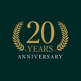 20 years old luxurious logo. Anniversary year of 20 th vector gold colored template framed of palms. Greetings ages celebrates. Celebrating laurel branches. 2 Stock Photos
