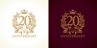 20 anniversary luxury logo. 20 years old luxurious logotype. Congratulating 20th numbers gold colored template framed in palms.  greetings celebrates Royalty Free Stock Image