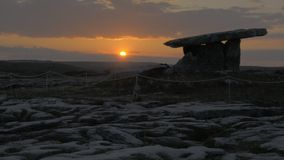 5000 years old Polnabrone Dolmen in Burren, National Park Sunset stock footage
