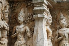 400 years old ruined ancient standing and praying of male angel statue at Chiangmai, Thailand, buddha statue. Without some of body part, historical decorated Royalty Free Stock Photos