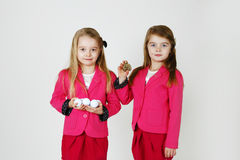 6 years old sisters. Two young girl ( sisters) in the studio Stock Photo