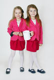 6 years old sisters. Two young girl ( sisters) in the studio Stock Images