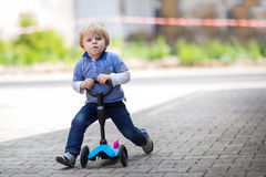 2 years old toddler riding on his first bike royalty free stock photos