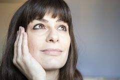 Young woman close-up portrait. Caucasian with brown long hair and bangs. 35 years old woman close-up portrait. Caucasian with brown long hair and bangs. Smiling stock photos