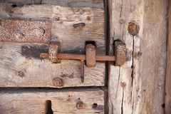 600 years old wooden doors with metal frame work and lock Royalty Free Stock Photography