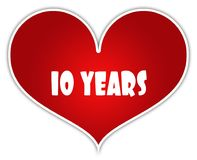 10 YEARS on red heart sticker label. Stock Photography