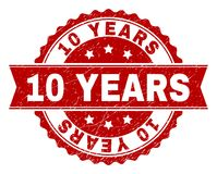 Scratched Textured 10 YEARS Stamp Seal. 10 YEARS seal print with distress texture. Rubber seal imitation has round medal form and contains ribbon. Red vector Stock Photo
