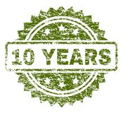 Scratched Textured 10 YEARS Stamp Seal. 10 YEARS stamp seal watermark with rubber print style. Green rubber print of 10 YEARS text with corroded texture vector illustration