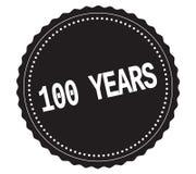 100-YEARS tekst na czarnym majcheru znaczku, Zdjęcie Stock