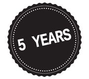 5-YEARS text, on black sticker stamp. 5-YEARS text, on black sticker stamp sign Stock Photos