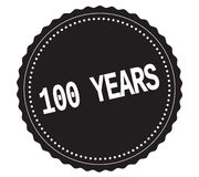 100-YEARS text, on black sticker stamp. 100-YEARS text, on black sticker stamp sign Stock Photo