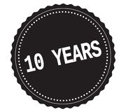 10-YEARS text, on black sticker stamp. 10-YEARS text, on black sticker stamp sign stock illustration