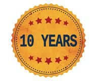 10-YEARS text, on vintage yellow sticker stamp. Stock Image