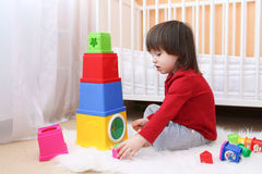 2 years toddler playing plastic blocks Stock Photos