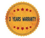 3-YEARS-WARRANTY文本,在葡萄酒黄色贴纸邮票 免版税库存图片