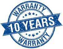 10 years warranty grunge retro blue ribbon stamp Stock Image
