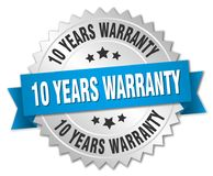 10 years warranty. Silver badge with blue ribbon royalty free illustration