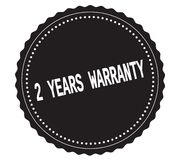 2-YEARS-WARRANTY text, on black sticker stamp. Stock Image