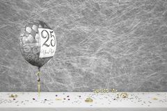 25 years wedding anniversary. Balloon & party decorations on a white table cloth royalty free stock photography