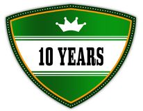 10 YEARS written on green shield with crown. Illustration Stock Illustration