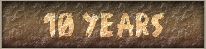 10 YEARS written with paint on rock panel background. Illustration Royalty Free Stock Photo