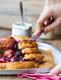 Yeast blueberry pie cut into pieces, hands Royalty Free Stock Photos