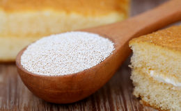 Yeast with bread. On wooden surface royalty free stock photography