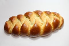 Yeast bun with a white background. The picture shows a yeast bun with a white background royalty free stock photo