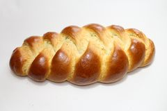 Yeast bun with a white background. The picture shows a yeast bun with a white background stock photography