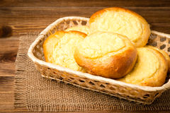 Yeast buns with cheese, traditional russian pastry, on the wooden background. Yeast buns with cheese, traditional russian pastry, on the brown wooden background Stock Photography