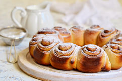 Yeast buns with cinnamon. Royalty Free Stock Photos