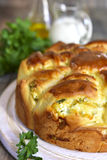 Yeast cake with feta and greens. Stock Photos