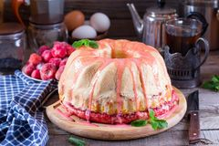 Yeast cake with icing on Easter. Yeast cake with icing on a wooden table on Easter Royalty Free Stock Photo