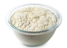 Yeast dough. In a glass bowl on white Royalty Free Stock Image