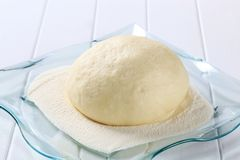 Yeast dough. On a cutting board Royalty Free Stock Image