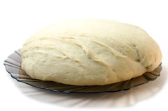 Yeast dough. The Yeast dough from wheat flour  on plate Stock Photography
