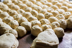 Yeast dough. Buns from dough. Dough rises on the table. Desserts making. Pies production. Baking buns. Flour products stock photography
