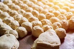 Yeast dough. Buns from dough royalty free stock image
